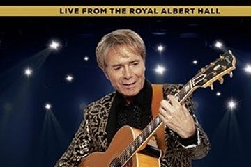 Cliff Richard holding a guitar