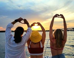 a man and a woman taking a selfie sunset catamaran