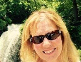 Nicole Garcia wearing sunglasses posing for the camera