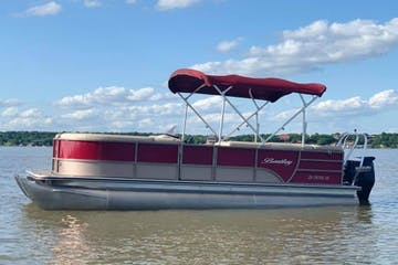 a pontoon boat in a large body of water