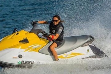 a person riding a jet ski in the water