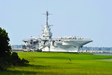 a large ship in the grass