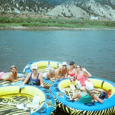 A group of women tubing on the Colorado River