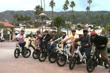 a group of people riding on the back of a motorcycle