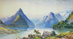 a large waterfall over a body of water with Milford Sound in the background