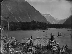 a vintage photo of a horse drawn carriage in front of a mountain