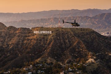 helicopter flying over the hollywood hills