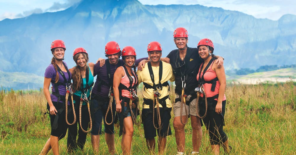 a group posing after a ziplining adventure