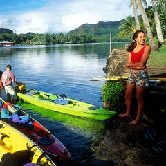A group starting a river kayak adventure