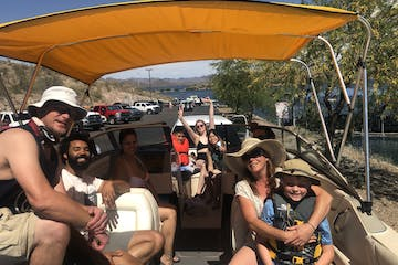 a group of people sitting on a boat