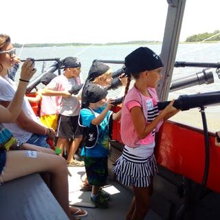 Kids firing water cannons
