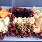 A selection of cheese and grapes