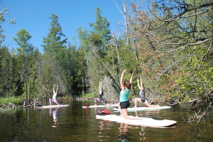 group doing SUP yoga