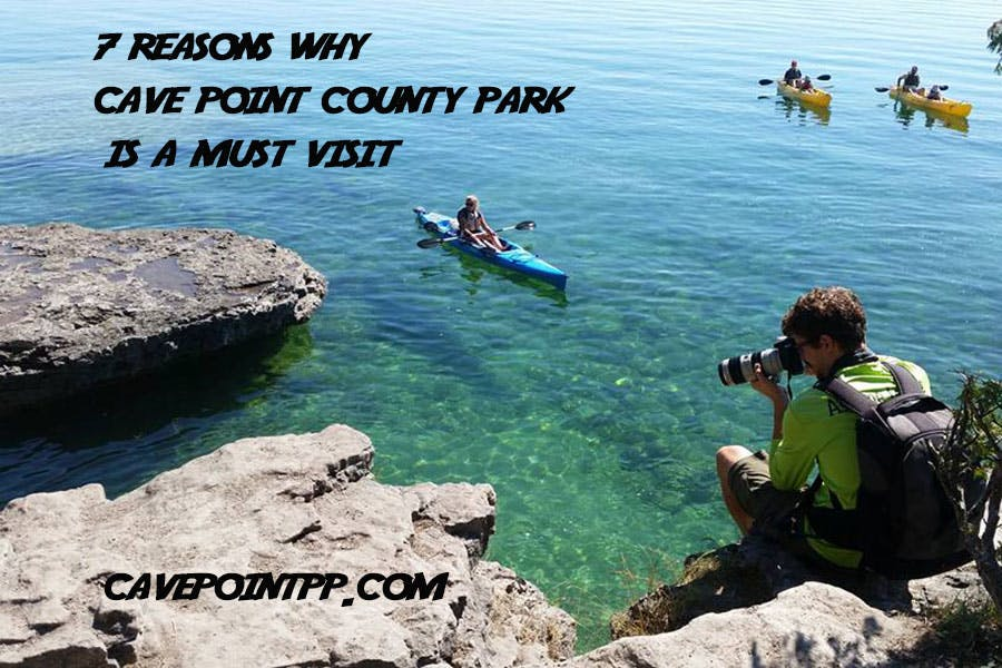 a photographer at cave point county park taking a photo of a kayak tour