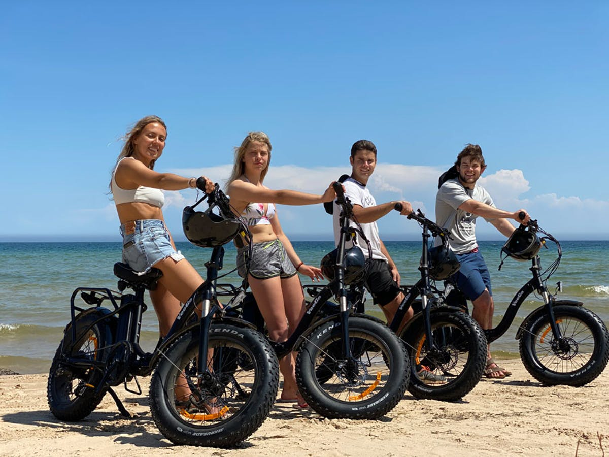 A group of friends renting fat tire e-bikes in Door County, Wisconsin