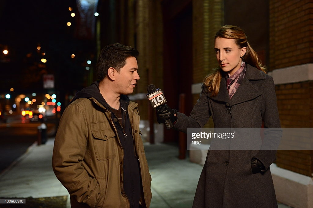 """THE MYSTERIES OF LAURA -- """"The Mystery of the Fateful Fire"""" Episode 112 -- Pictured: (l-r) Max Jenkins as Max Carnegie, Elyse Brandau as reporter -- (Photo by: Nicole Rivelli/NBC/NBCU Photo Bank)"""