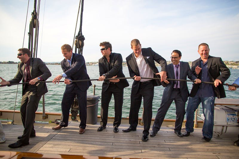 Men dressed to impress on the yacht america
