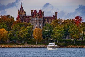 a large body of water with Boldt Castle in the background