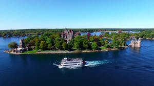 Boldt Castle on Heart Island with Uncle Sam Tour Boat passing by
