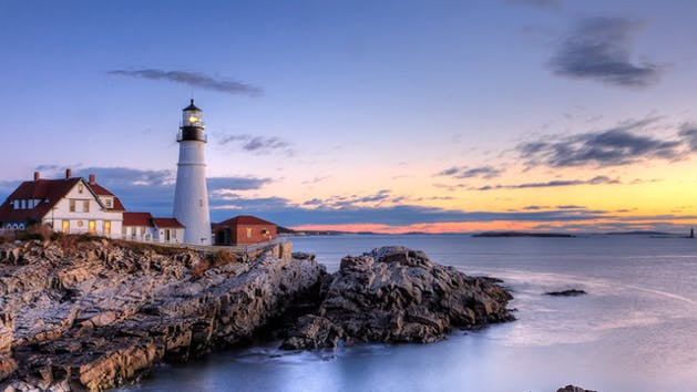 Maine lighthouse with sunset in background