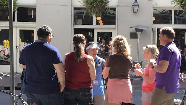 A tour group learning more about the French Quarter