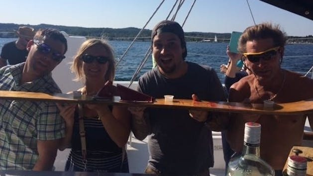 a group doing shotskis on the Nauti-Cat