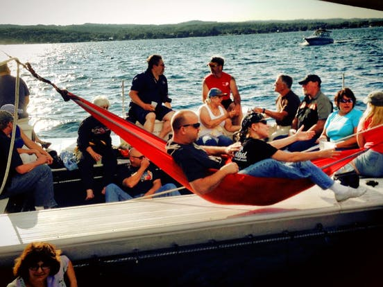 A group enjoying themselves on the Nauti-Cat in a hammock