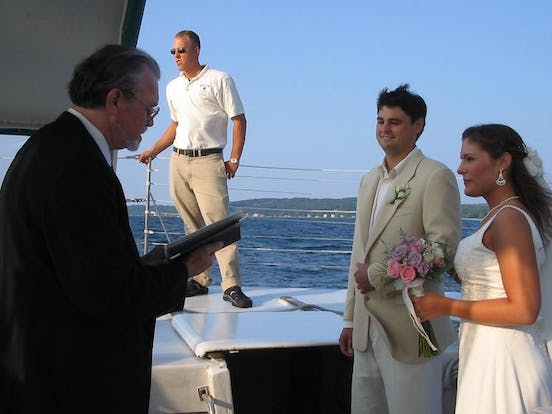 A couple getting married on the Nauti-Cat