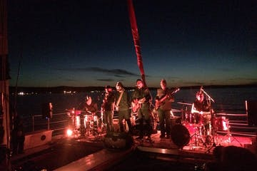 A band playing on the Nauti-Cat