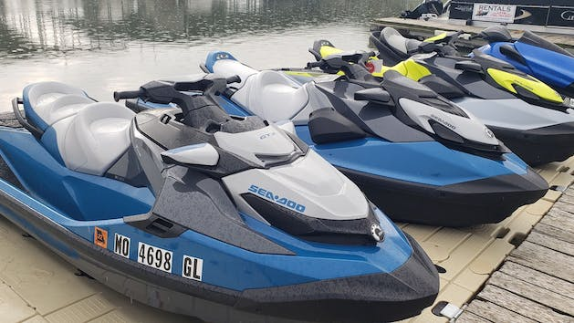 a row of jet skis at the dock