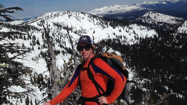 Backcountry skier tours along mountain ridge