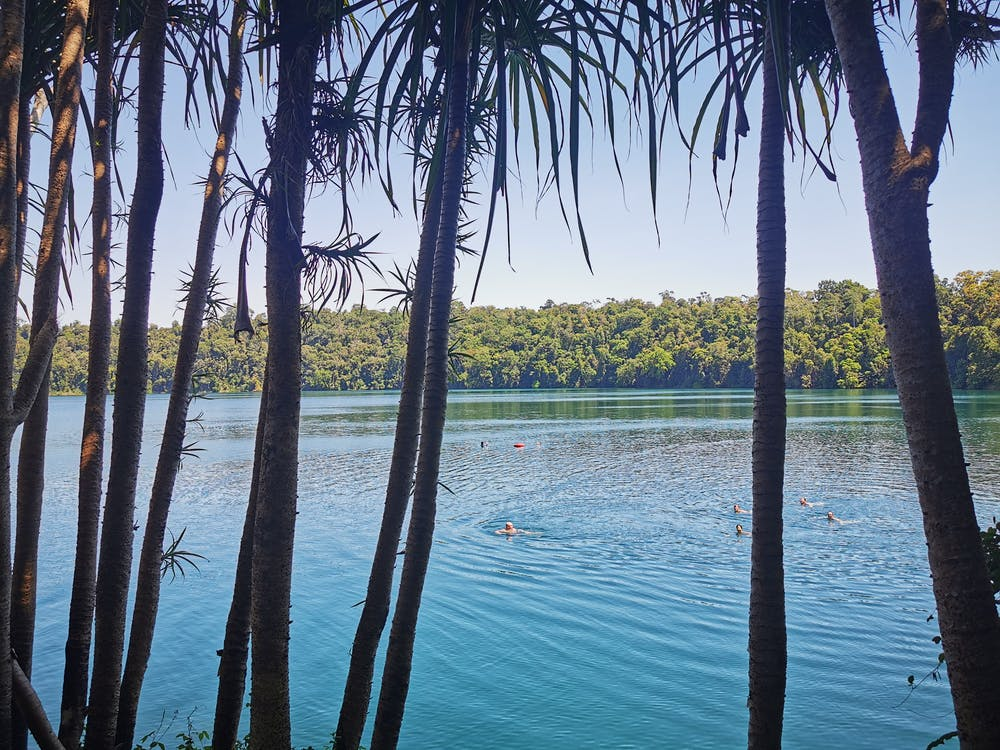 Looking through the trees to the Volcanic Crater Lake Eacham