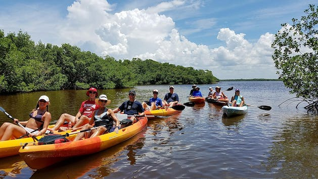 people on a kayak tour in estero bay