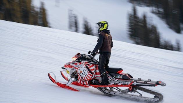 person on a snowmobile tour