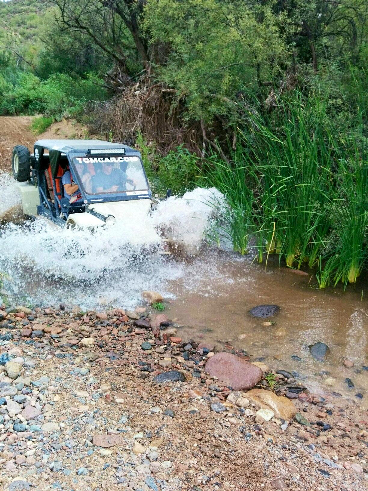 Tomcar ATV tour crossing river Scottsadle