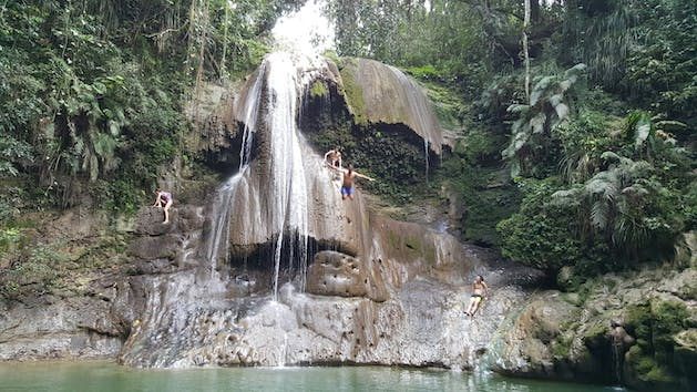 People jumping from waterfall