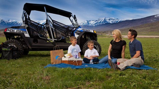A family having a picnic next to their razor