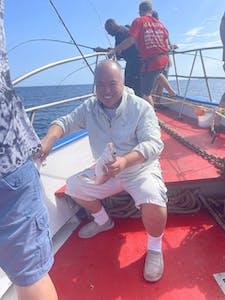 a man sitting on a boat