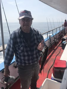 a man standing on a boat