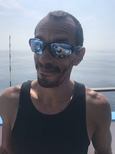 a man wearing sunglasses taking a selfie