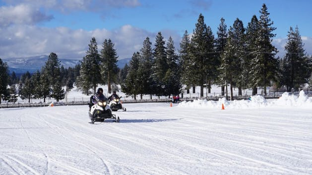 Person driving a Snowmobile Rental
