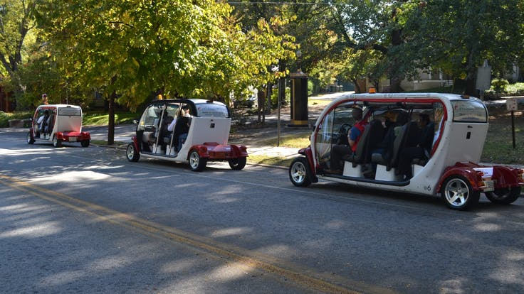Three groups on an electric car tour