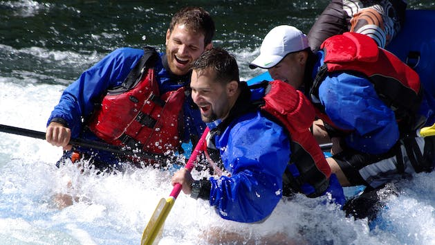 Excited whitewater rafters navigate a rapid