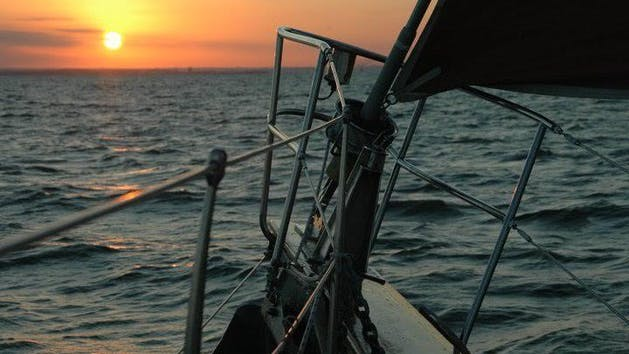 Bow Of Boat Facing Sunset