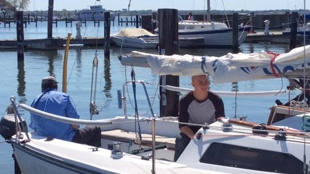 Men Get Ready To Learn How To Sail