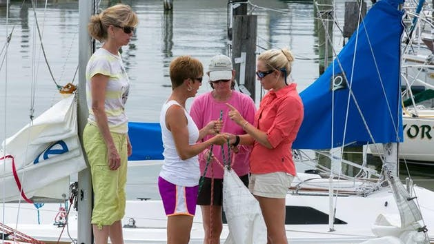 Women Preparing Sails for Their Course