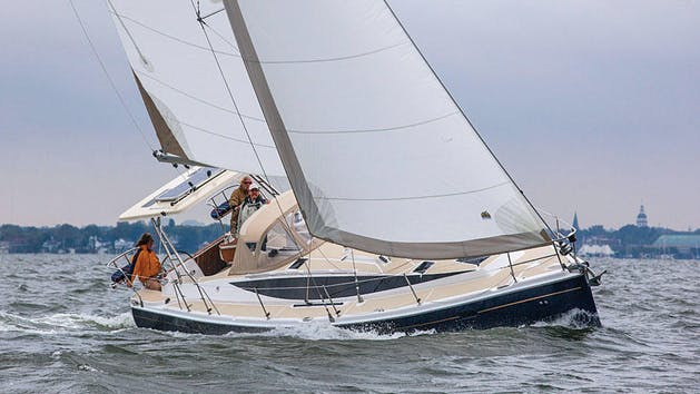 Large Sailboat on a Starboard Heel Heading Up Wind