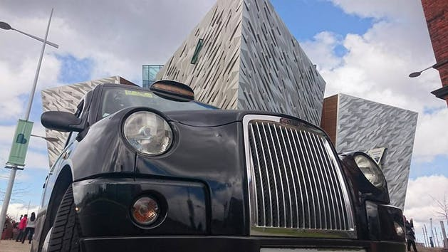 A close up of a taxi cab in front of the titanic museum