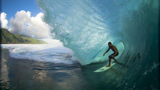surfer under wave
