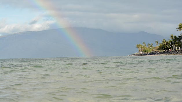 a rainbow over a body of water